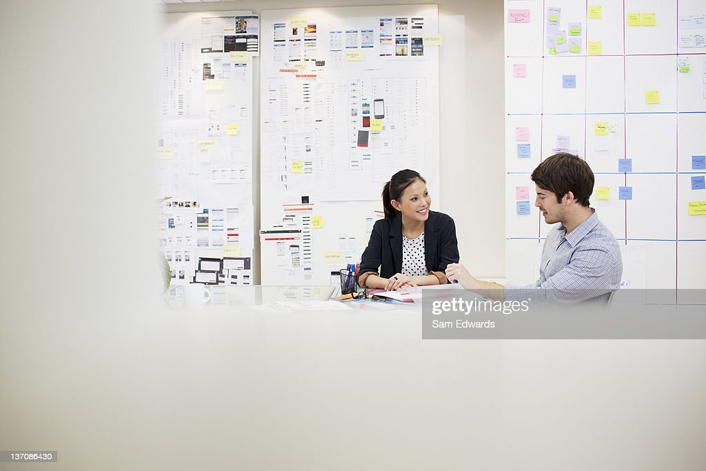 Businessman and businesswoman talking in meeting : Stock Photo