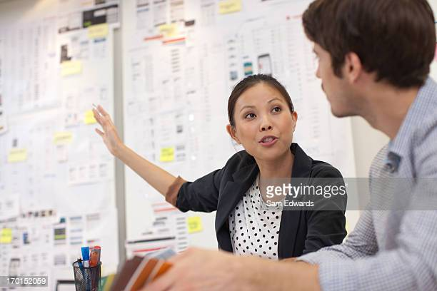 businessman and businesswoman talking in meeting - face to face stock pictures, royalty-free photos & images