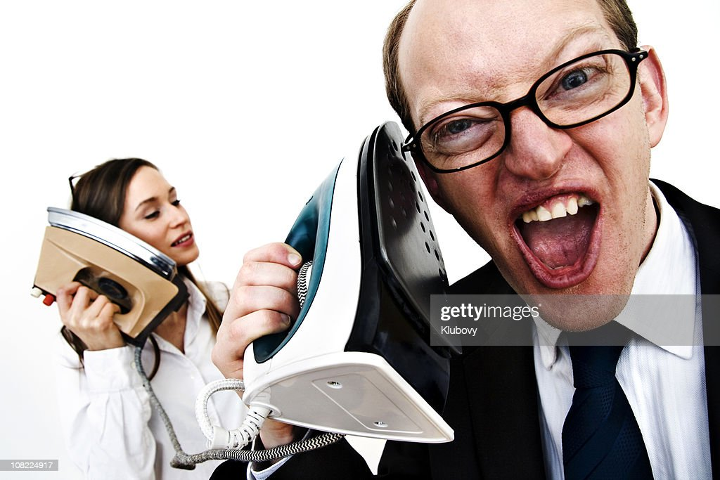 Businessman and Businesswoman Talking on Irons : Stock Photo