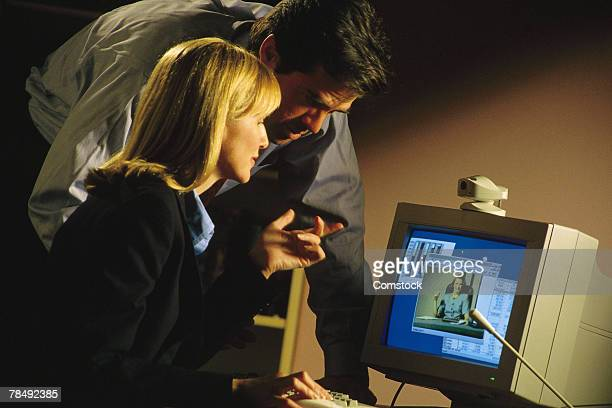Businessman and businesswoman using video conference