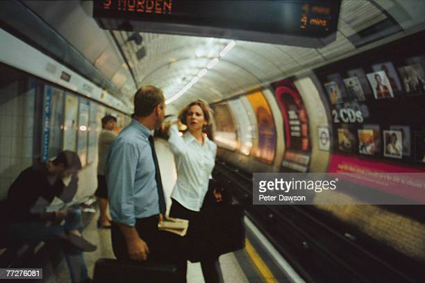 Businessman and businesswoman waiting for subway