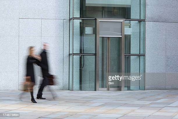 Businessman and businesswoman walking in a London's financial district