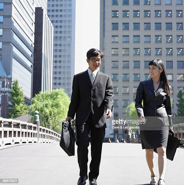 Businessman and businesswoman walking