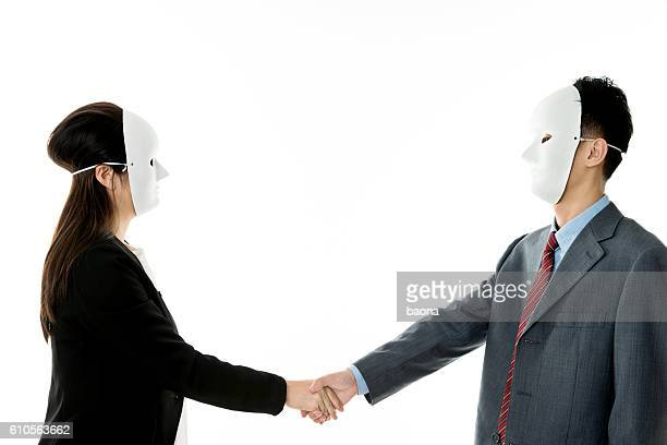 Businessman and businesswoman with mask handshake