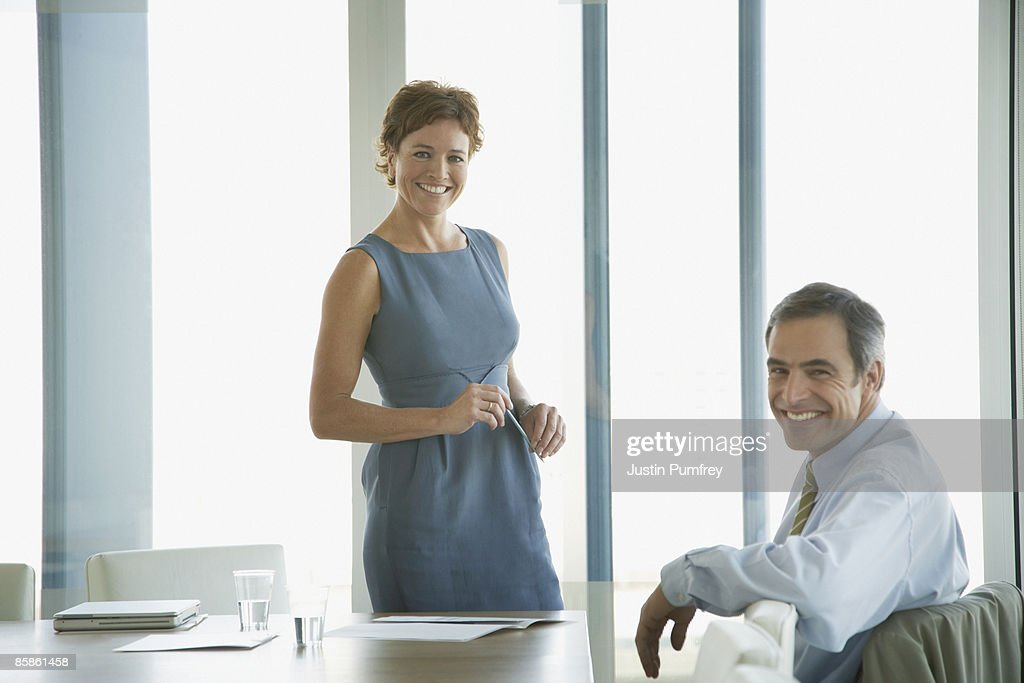 Businessman and businesswoman working in office : Stock-Foto