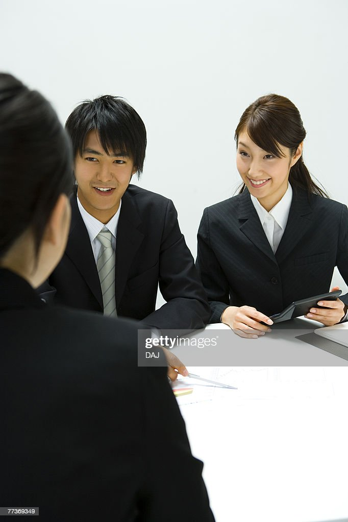 Businessman and Businesswomen In Meeting, Front View, Rear View : Photo