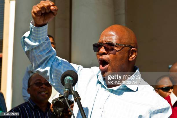 Businessman and chairperson of the Save South Africa movement Sipho Pityana addresses the crowd as supporters of the Save South Africa campaign civil...