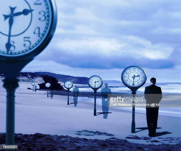 businessman and clocks - time travel stock pictures, royalty-free photos & images