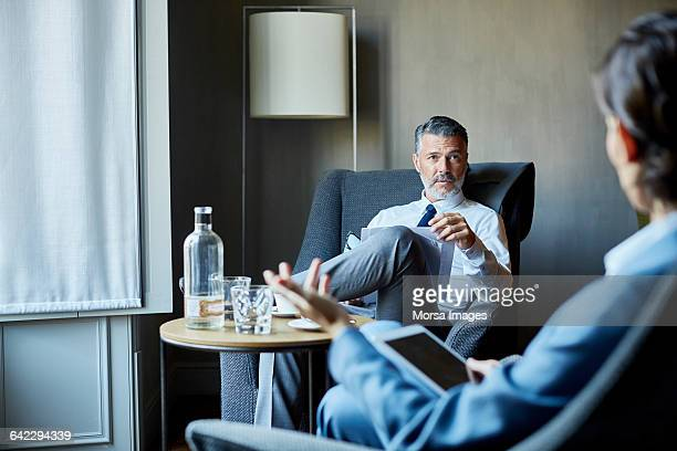 Businessman and colleague at meeting at hotel room