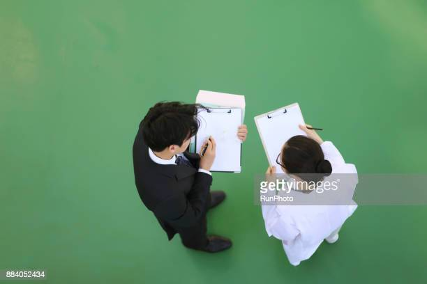 Businessman and doctor talking in meeting