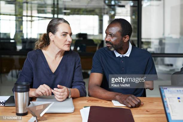 businessman and entrepreneur in office meeting - differing abilities female business fotografías e imágenes de stock
