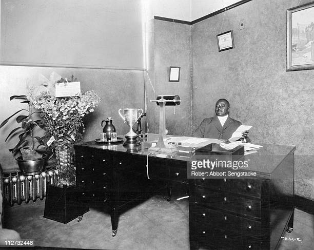 Businessman and founder of the Chicago Defender newspaper Robert Sengstacke Abbott sits in his office, 1933.