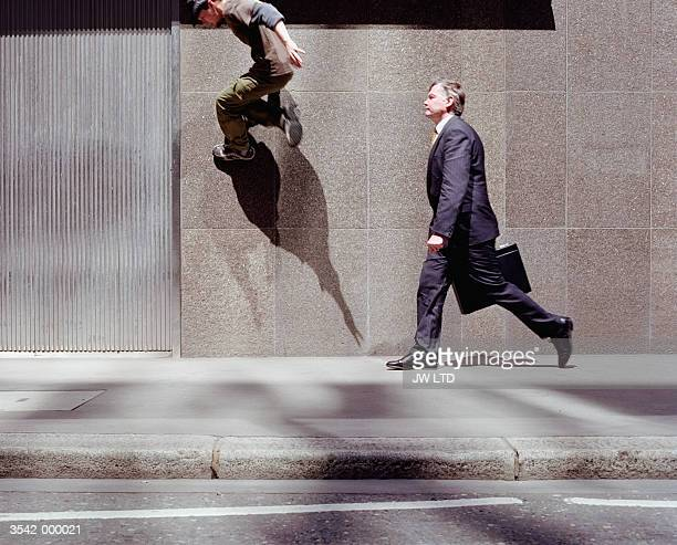 businessman and free runner - contrasts stock pictures, royalty-free photos & images