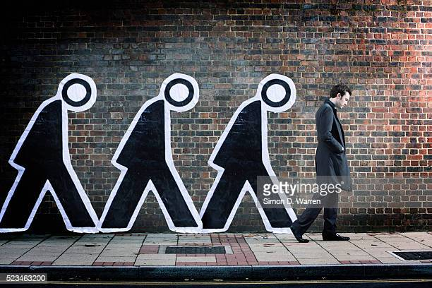 Businessman and Human Figures Walking