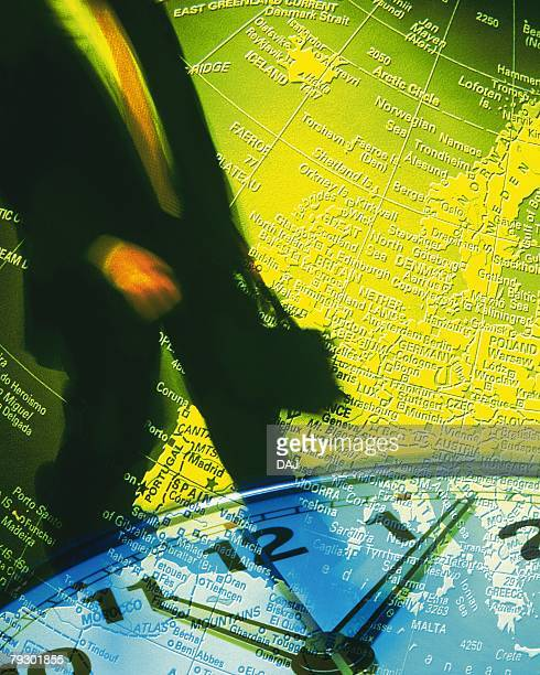 Businessman and image of globe and clock, CG, composition, blurred motion