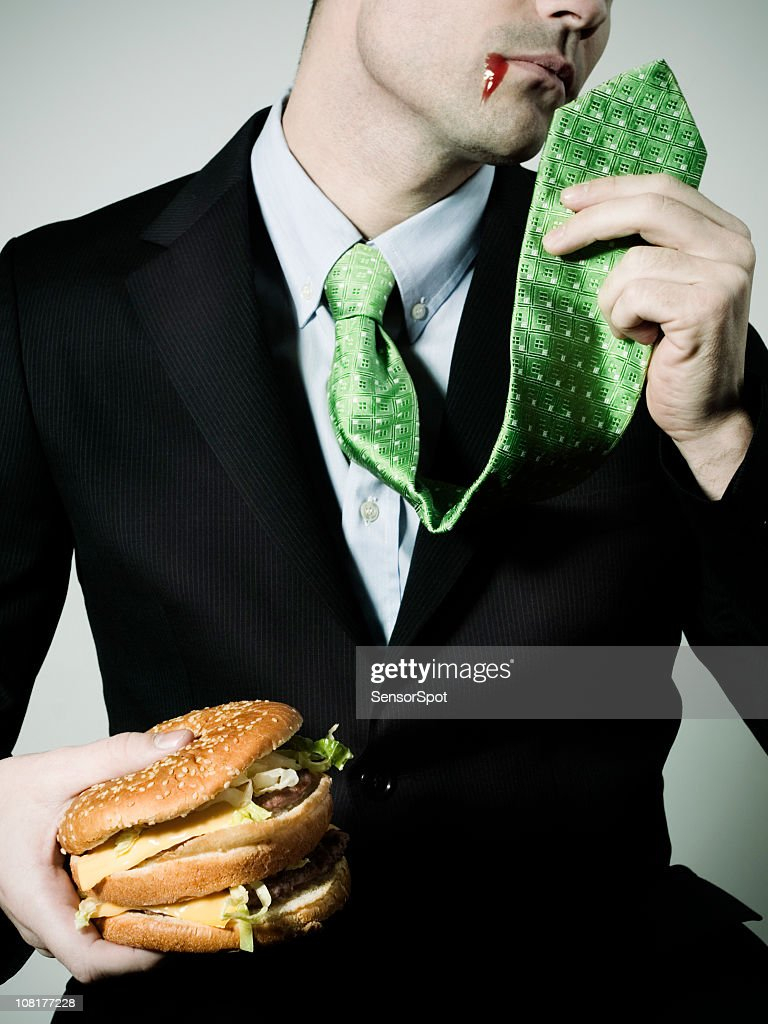 Businessman with problems to eat at work.