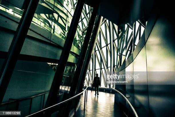 businessman and modern futuristic interior office architecture in the city - office stock pictures, royalty-free photos & images