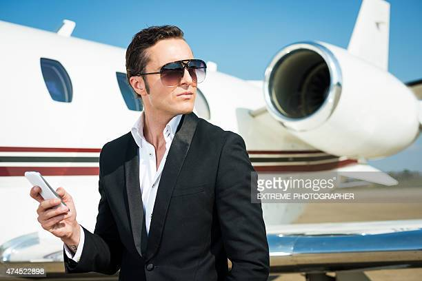 Businessman and private jet airplane