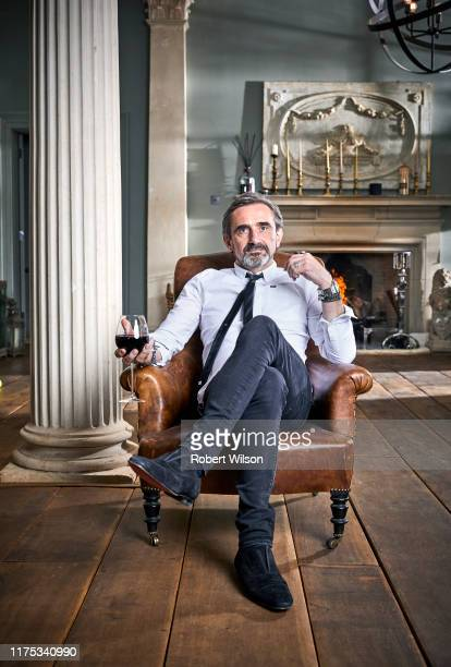 Businessman and the cofounder of the fashion label Superdry Julian Dunkerton is photographed at his home for the Times magazine on May 10 2019 near...