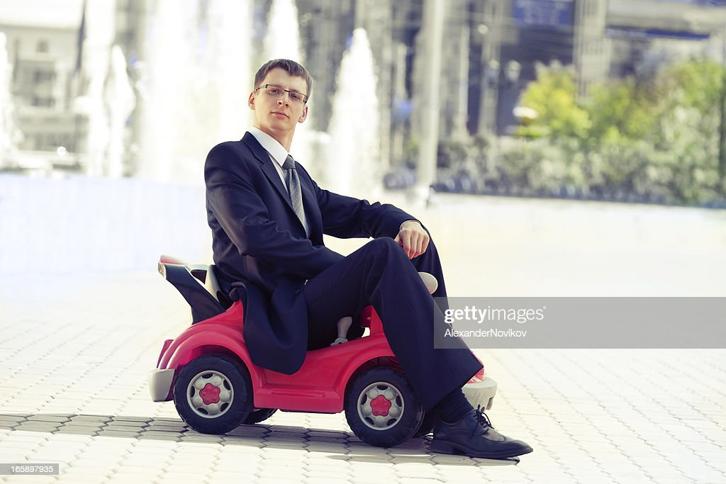 Businessman and Toy Red Car . : Stock Photo