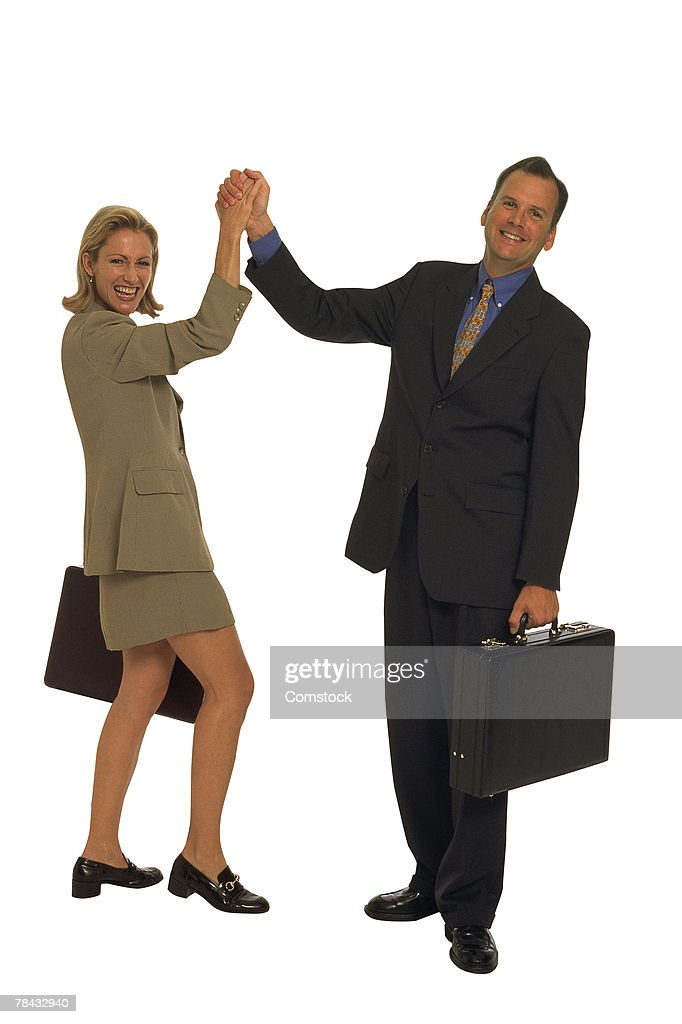Businessman and woman congratulating, each other : Stockfoto