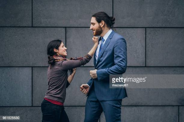 Businessman and woman fighting