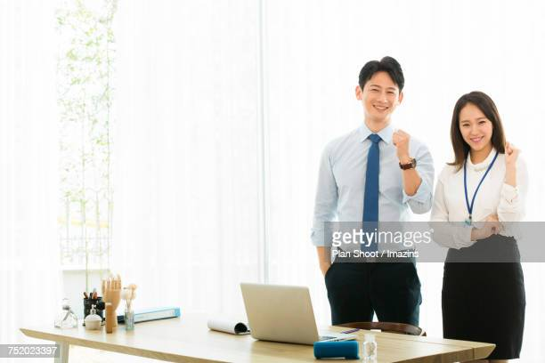 Businessman and woman holding a meeting