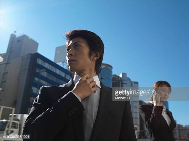 Businessman and woman in front of office buildings
