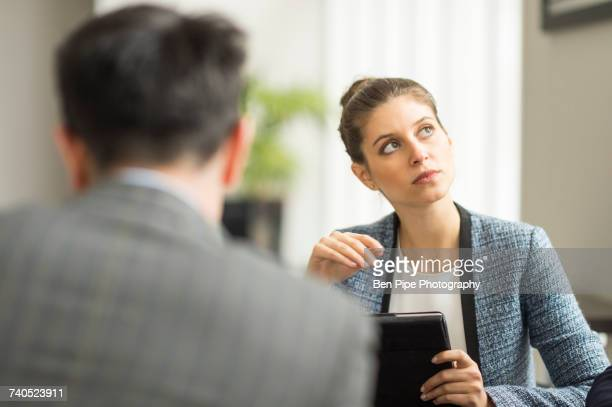 Businessman and woman in office meeting