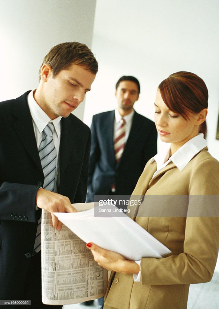 Businessman and woman looking at document together. : Stockfoto
