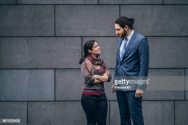Businessman and woman looking at each other