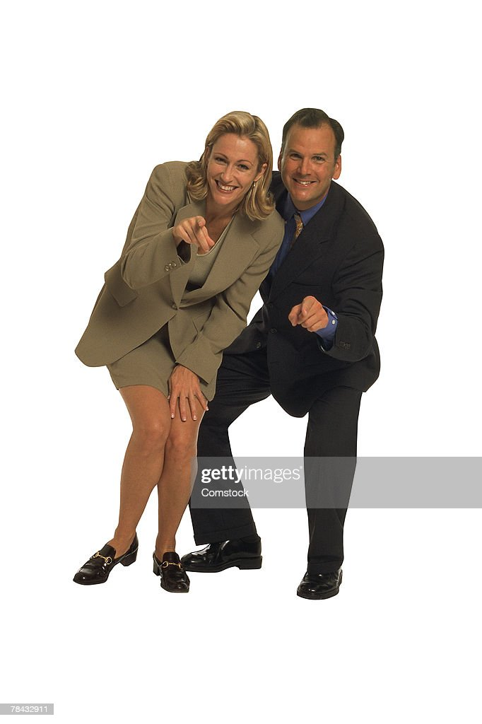 Businessman and woman pointing at you : Stockfoto