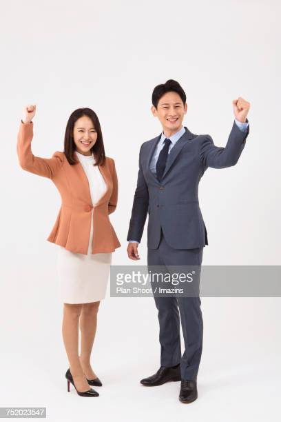 Businessman and woman taking a pose