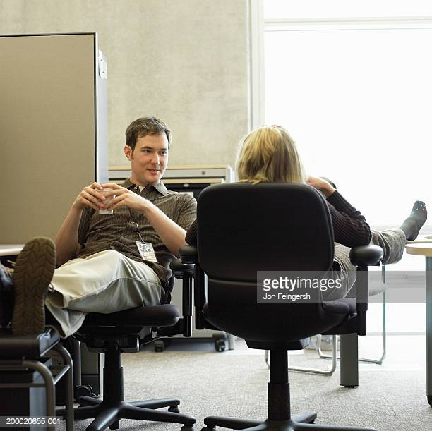 Businessman and womantalking in office
