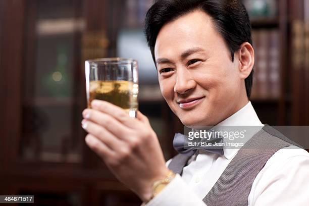 Businessman appreciating fine wine