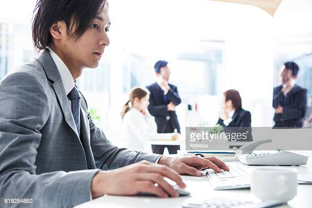 Businessman are using a computer in the office