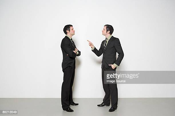 businessman arguing with himself - cloning stock pictures, royalty-free photos & images