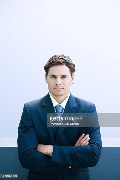 Businessman, arms crossed, waist up, portrait