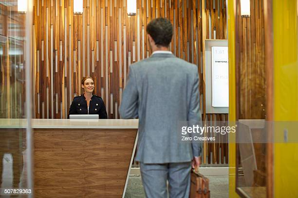 Businessman arriving at office reception
