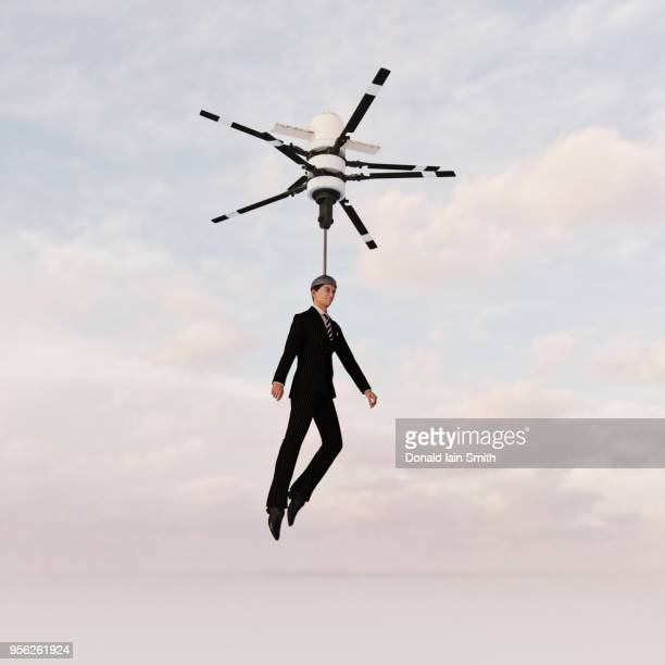 businessman arriving by drone - helicopter photos stock pictures, royalty-free photos & images