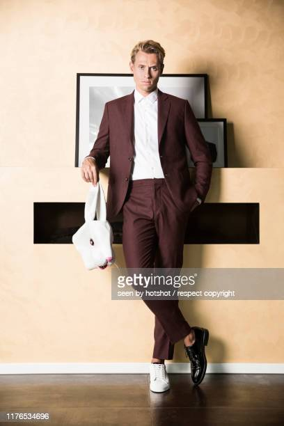 businessman as bunny - rabbit mask stock pictures, royalty-free photos & images