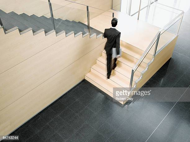 Businessman ascending office stairs