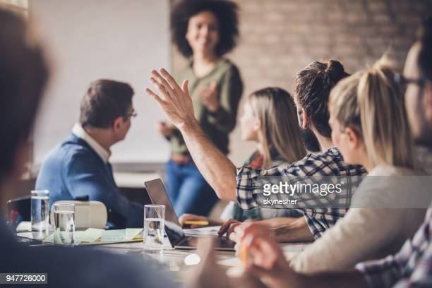 businessman asking a question on a meeting in the office. - corporate business stock pictures, royalty-free photos & images