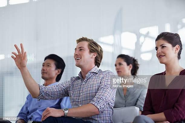 Businessman asking question in seminar