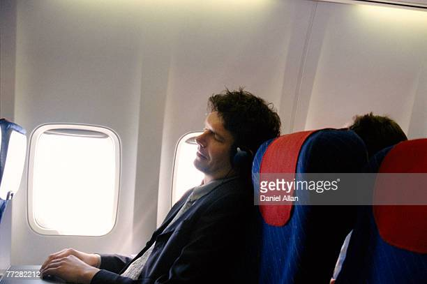 Businessman asleep on an airplane