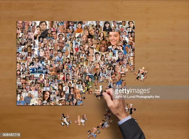 businessman assembling puzzle of collage of smiling face - igualdade - fotografias e filmes do acervo