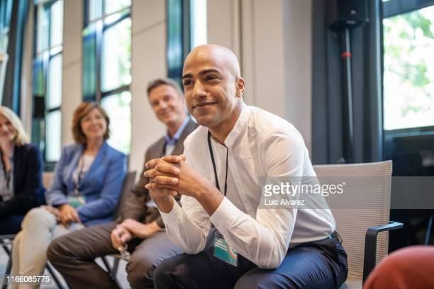 businessman at a networking seminar - パネル討論 ストックフォトと画像