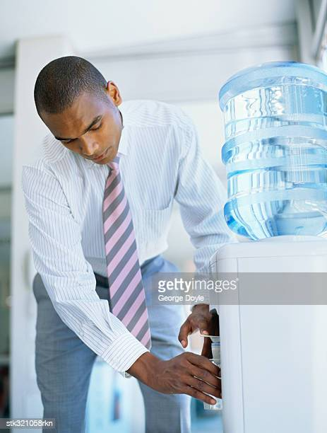 businessman at a water cooler in an office