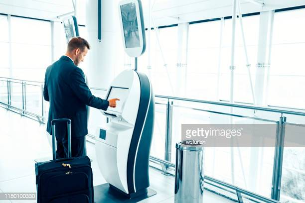 businessman at an airport. - kiosk stock pictures, royalty-free photos & images