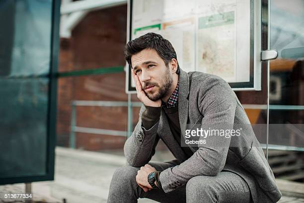 businessman at bus station - waiting stock pictures, royalty-free photos & images